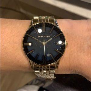 Anne Klein gold and black watch